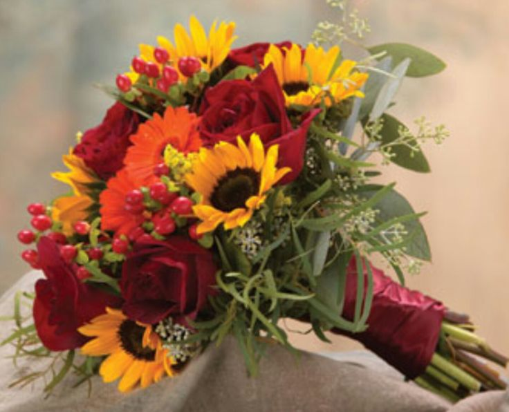 Fall/Autumn Wedding Bouquet: Red Roses, Orange Gerbera Daisies, Yellow Sunflowers, Greenery & Green Seeded Eucalyptus