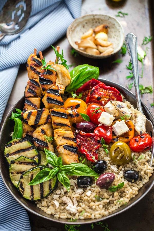 Grilled Greek Chicken Souvlaki Quinoa Brown Rice Bowls - the perfect easy weeknight meal. Best of all, so easy to customize the Mediterranean vegetables mix