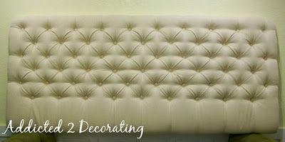 Upholstered and tufted headboard....except mine will be at least 6 feet tall!