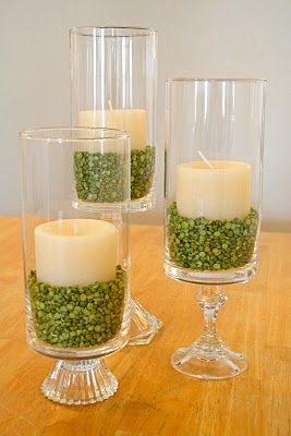 Use split peas, beans, barley, coffee beans, rice, pasta, etc. for hurricane and candle centerpieces