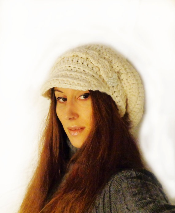 Handmade newsboy slouchy hat from wool blend yarn, very soft, comfortable and warm.  I add glass beads on the sides, something different than other hats and beautiful.    This hat is off white in color.  Fits all sizes    Hand wash in lukewarm water and lay flat to dry for best care.    Plus with each item purchase i will give a small gift!
