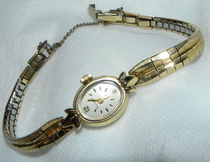 """Lady Bulova horloge 14 K gouden horloge en 10 K armband 12 97 g  Dit bepaalde horloge is een Lady BulovaDe behuizing is ongeveer 300 x 1.5 x 0.8 cm 14 K goudDe kroon draagt de """"B"""".De band is een oorspronkelijke Verenigde Staten van hertogin top 10 K goud.Het is een collector's item. Het komt uit de Verenigde Staten ongeveer vanaf de jaren 50/60. Het was zelden gedragen. Ze is goed het werk is super zacht tikkende!Verzekerde verzending  EUR 34.00  Meer informatie"""