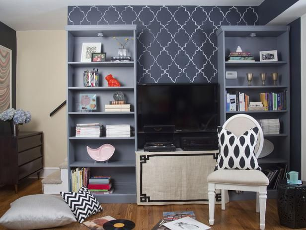 Create a media center on a budget,  with customized bookcases with crown molding and charcoal grey paint and a piece of plywood between them as a TV stand. (http://www.hgtv.com/decorating-basics/a-painters-diy-small-condo-design/pictures/page-8.html?soc=pinterest): Diy Small, Paintings Patterns, Painters Diy, Paintings Bookcases, Condos Design, Small Condos, Condos Budget Decor Ideas, Crowns Moldings, Grey Paintings