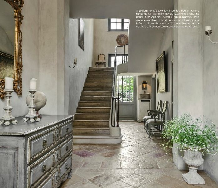 Burgundian stone and the French antique staircase in this beautiful home by Pamela Pierce.