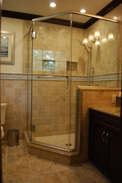 love this large corner custom ceramic tile shower with all the glass