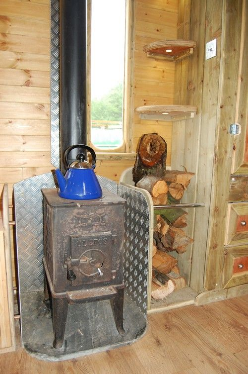 stove corner wall protection and wood cubby http
