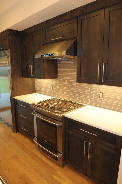 glass backsplash and slide in gas range kitchen remodel