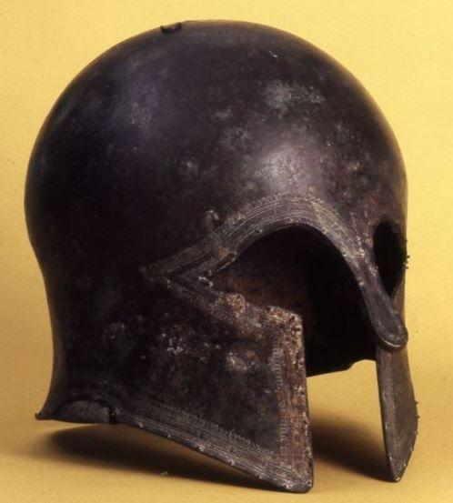 "DODONA: Bronze Corinthian helmet with the inscription ""ΟΛΥΜΠ"", 650-570 BC. Excavated at the Sanctuary of Zeus, Dodona and now in the British Museum, London."