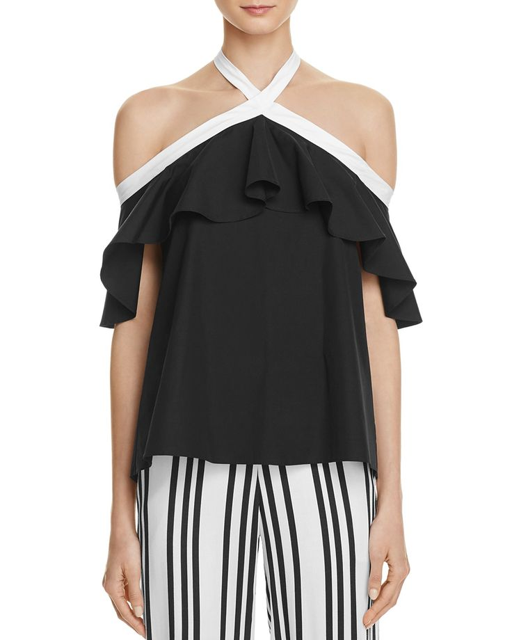 Bare-shoulder styling and stark, contrast trim define the of-the-moment appeal of this Alice + Olivia top, an exclusive design created expressly for our 100% capsule collection. | Self and contrast: c