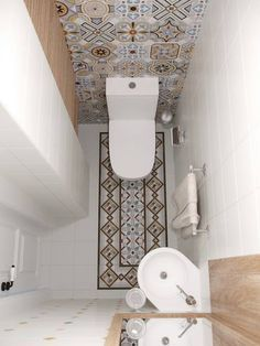 Idée de l'évier en coin intéressante pour la petite salle d'eau. Peut-être un peu trop de motifs à mon goût, côté carreaux.