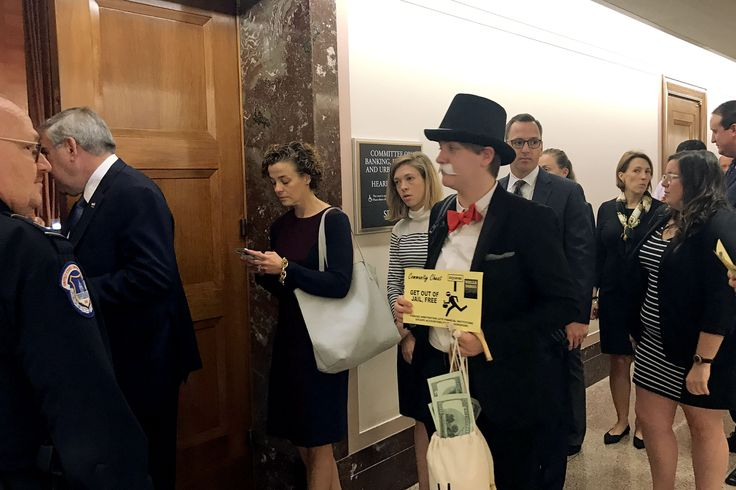 'MONOPOLY MAN' SHOWS UP AT WELLS FARGO HEARING AS SENATE PUSHES TO LEGALIZE RIPOFF CLAUSE    Sen. Elizabeth Warren effectively accused Wells Fargo CEO Tim Sloane of securities fraud over his response to the bank's fake accounts scandal.