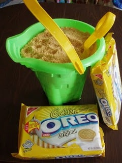 Edible Sand Recipe. At first I thought this was really gross, but then I realized there are layers of stuff within the bucket. It's a neat idea for a program snack!
