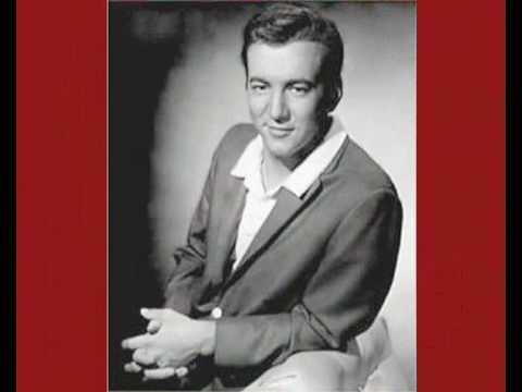 Bobby Darin - Beyond the Sea.  A song that I never get tired of playing at weddings.  Your older adult guests will love it!