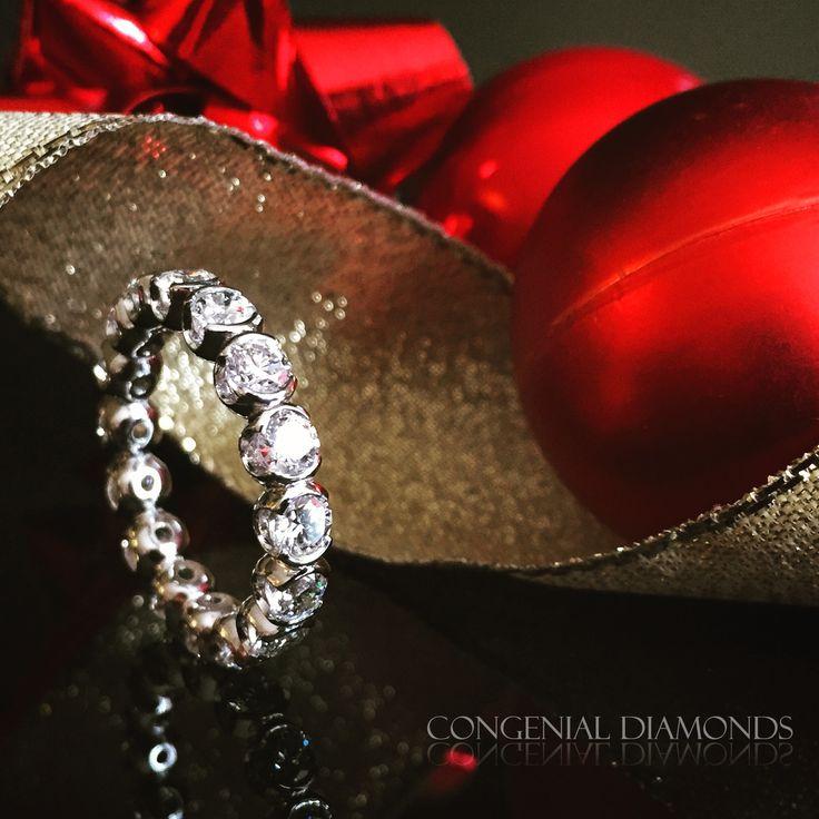 Stunning diamond ring with semi rubover setting
