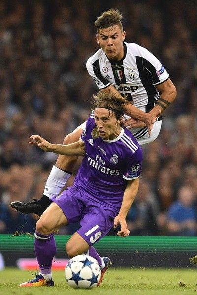 Juventus' Argentinian striker Paulo Dybala (R) is fouled by Real Madrid's Croatian midfielder Luka Modric during the UEFA Champions League final football match between Juventus and Real Madrid at The Principality Stadium in Cardiff, south Wales, on June 3, 2017. / AFP PHOTO / Glyn KIRK