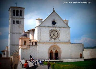 """The Basilica of St. Francis in Assisi.  Scratch it off your bucket list. Find out more at """"Down the Wrabbit Hole - The Travel Bucket List"""". Click the image for the blog post."""