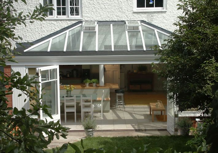 013 Wide opening doors lead from conservatory kitchen extension in near Richmond South West London