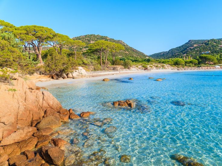 Camp out on a secluded beach on the island of Corsica.
