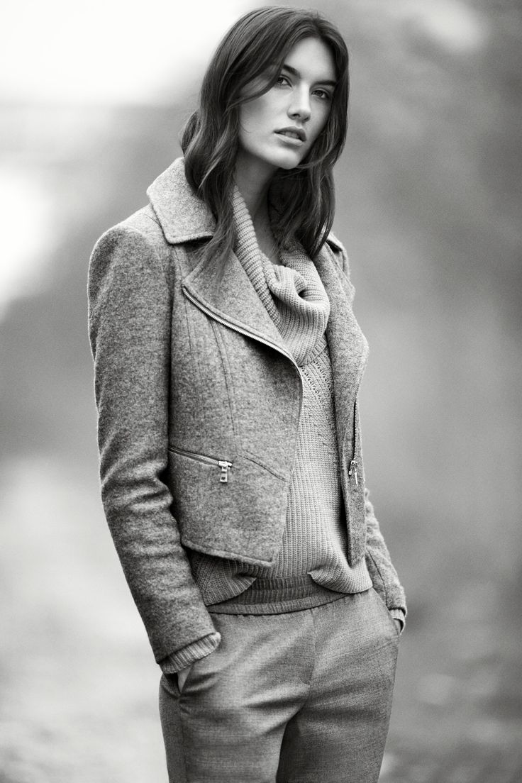 THE NEW NEUTRALS. Twilight-imbued hues and knits, from sun-washed earth tones to stone grey stripes. Ann Taylor's Boiled Wool Moto Jacket layered over the Cowl Neck Sweater is the ideal embodiment of this fall's lush layering trend.