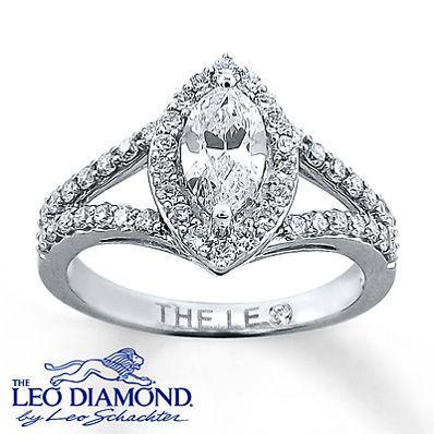 Framed in round diamonds, a marquise Leo Diamond delivers exceptional  brilliance to this breathtaking ring