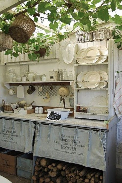 Burlap Sack covering shelving for antique feeling, wood storage in shed or greenhouse, plants on ceiling