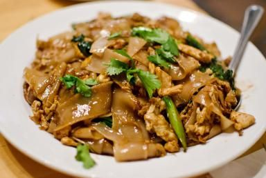 Thai Chicken and Broad Rice Noodles Fried with Soy Sauce (Pad See Ew).