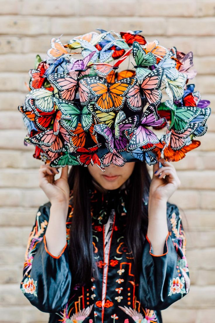"""Phillip Treacy hat from 2003 worn by Naomi Campbell on the cover of Tatler in 2004 and the basis of the red butterfly hat in Alexander McQueen's S/S 08 """"La Dame Bleu"""" collection worn with vintage Chinese jacket"""