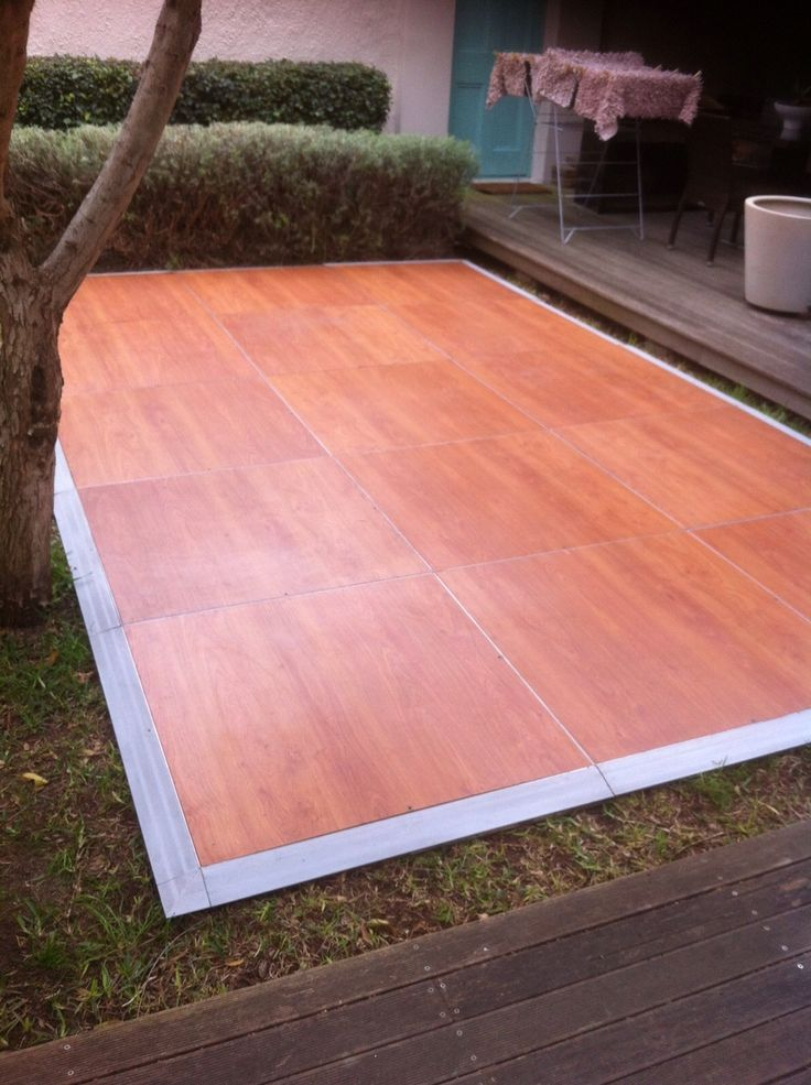 Savannah Connecta-Floor placed between a deck & a tree_August 2015
