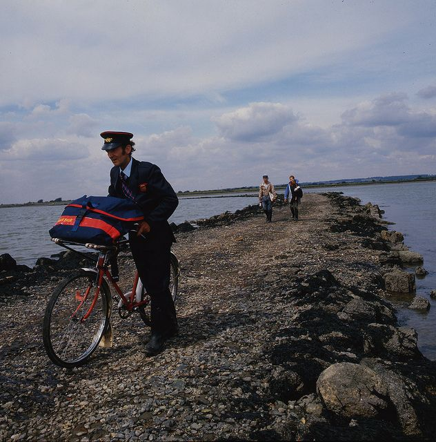 Postman delivering to Osea Island, Essex by British Postal Museum & Archive, 1987