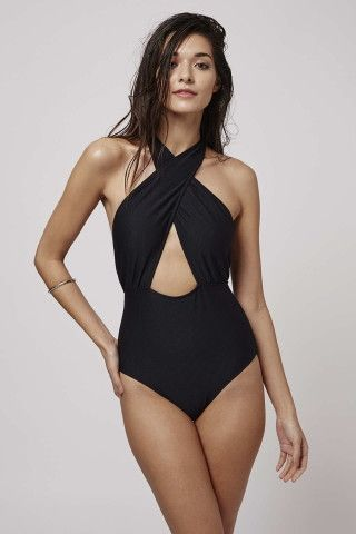 Think statement shapes for the beach in this cross-front wrap #style #swimsuit. With a revealing cut-out front, it is finished with an edgy wrap-around neck line and textured detail. 96% Polyamide, 4% Elastane. Machine wash.