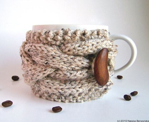 I'm in love... nothing says fall/winter better than a hot cup of coffee and a chunky cable sweater, not it's all in one!