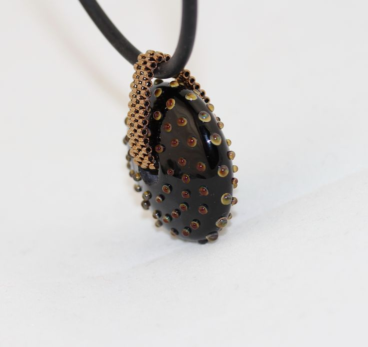 Black-bronze color combination. The beaded loop made with delica beads.