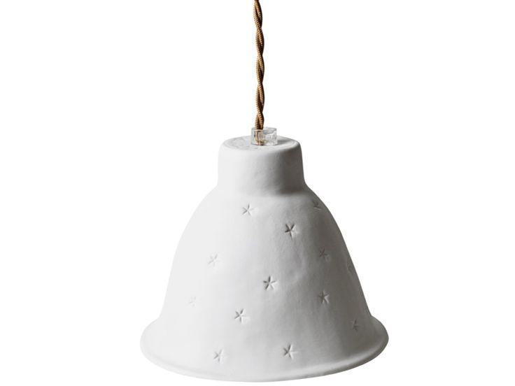 Luminaire en porcelaine de Limoges fabriqué à la main. Livré avec son cache-domino en porcelaine. La lumière fait apparaître par transparence des p...