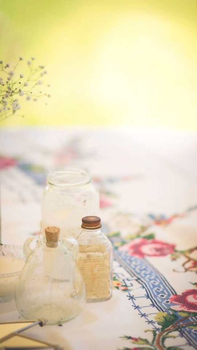 My grandmothers lace table cloth and vintage jars at our vintage country wedding