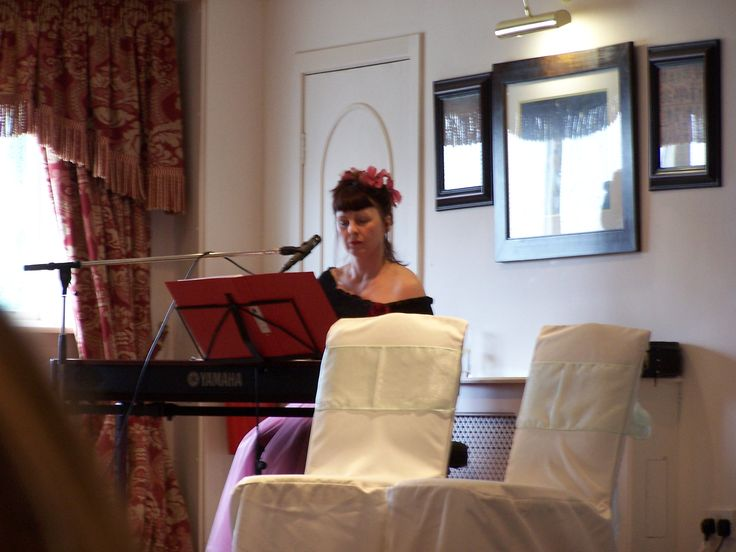 Sam Brown (yes, THE Sam Brown) playing piano and singing at Daryl & Karen's wedding. 2009.