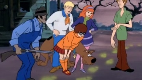 Scooby Doo and the gang searching for clues