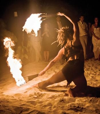 Hire local fire dancers for entertainment at your beach wedding | Photo by Jag Studios