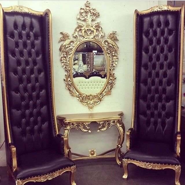 black tufted high back chairs trimmed in gold