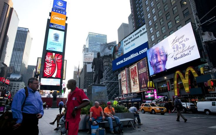 An electronic billboard announces Nelson Mandela's 95th birthday in New York's Times Square