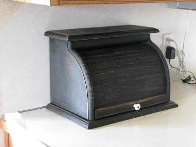 clean up an old breadbox and turn into a clutter hider! place c-shaped hooks to hang keys and organize mail/bills.