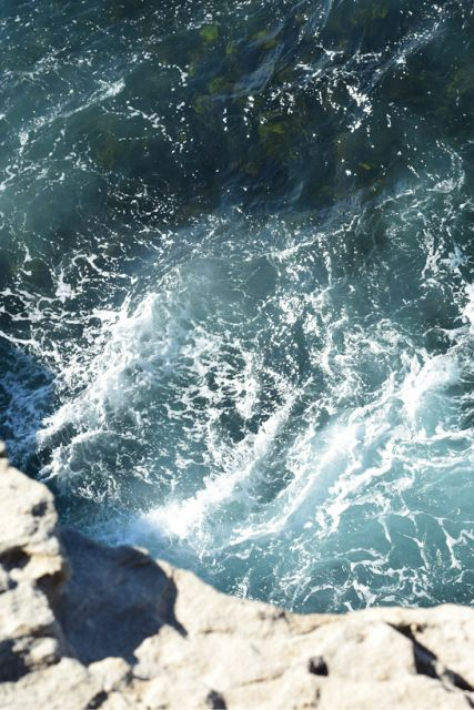 crashing waves, edge of a cliff