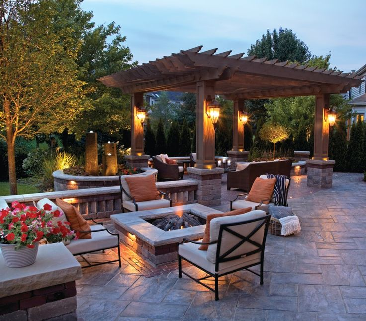 incredible Unilock outdoor living space with fire pit and fountainscape