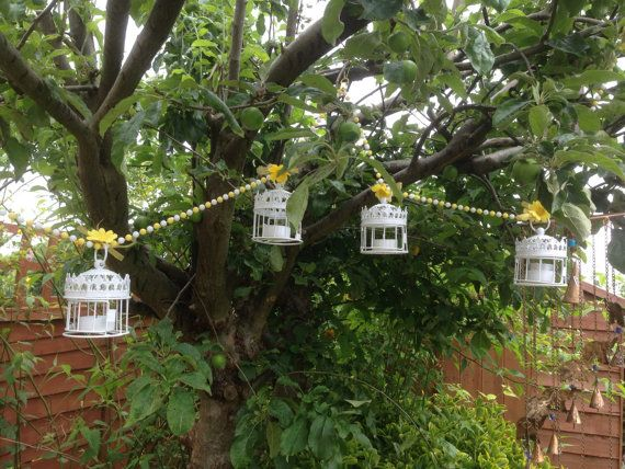 Garden lanterns garden bunting outdoor lanterns by Charmingifts. I could put flowers in here