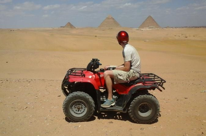 Desert Safari by Quad Bike Around Pyramids Be picked up from your hotel in Cairo or Giza to enjoy the only place in Egypt where you can experience the wonders of the ancient world on a quad bike tour.Your desert safari trip to the Giza Pyramids will start with picking you up from your hotel in Cairo or Giza to enjoy the only place in Egypt where you can experience the wonders of the ancient world through the quad bike tour.You will picked up from your hotel by A/C van to the Q...