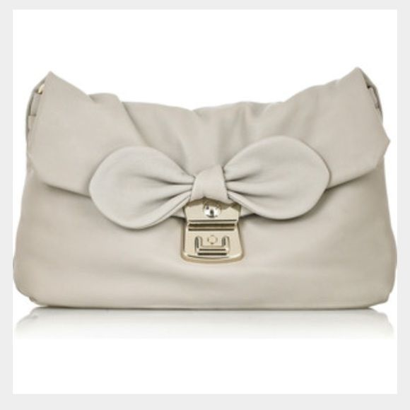 ⚫️⚪️SALE-Marc by Marc Jacobs clutch Between the bow detail and the heart lining, this purse is enough to put a smile on any ones face! Girlie details with sophistication...smooth grey leather and silver details make this a must get! Can be worn two ways...as a clutch or a shoulder bag! Not a mark!! Marc by Marc Jacobs Bags Clutches & Wristlets