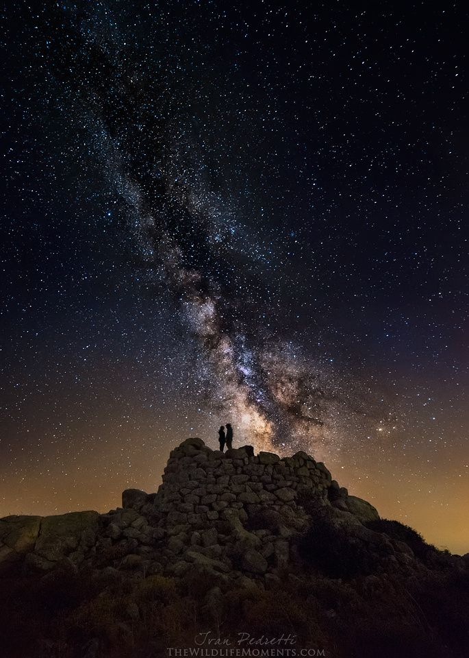 "Starry lovers ... ""For small creatures such as we, the vastness is bearable only through love."" ~ Carl Sagan --- Two lovers under the milky way, standing atop a ""nuraghe"", a type of ancient megalithic edifice found in Sardinia, developed during the Nuragic Age between 1900 and 730 BCE. 