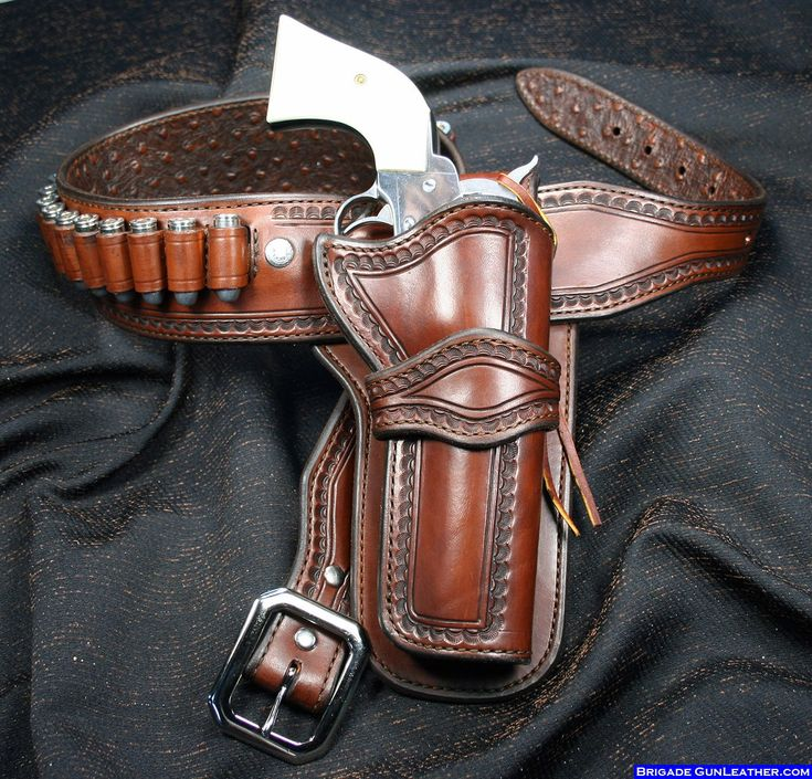 """The Russellville is a simple style belt with a buscadero style holster. The straight belt is 2.75"""" wide and tapers to 1.5"""" at the buckle and strap ends. It is fully leather lined with 24-30 cartridge loops (actual number of loops will vary with waist size), which are centered in the back to allow for both right and left-handed holsters. It is fitted with a solid brass triple nickle plated western buckle. This rig fits just above your existing pants belt."""
