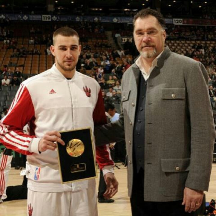 Arvydas Sabonis presents Jonas Valanciunas with the 2012 Lithuanian basketball player of the year award in Toronto.