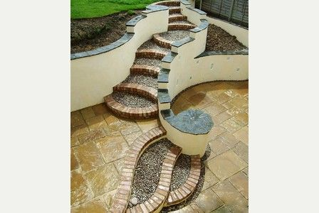 Lay out is key to year-round garden enjoyment. In this case, Tom Phillips uses gently curving steps to overcome a steep slope