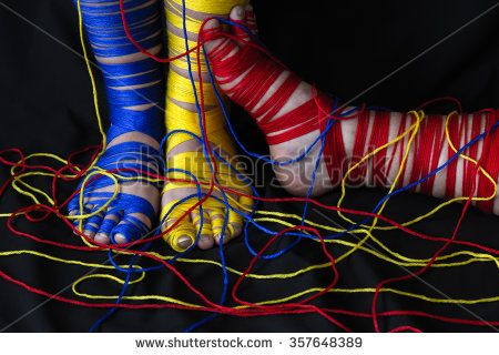 Fun and playful, these feet were wrapped in yarn in the primary colors and on black this makes a stunning photo in a horizontal format and great for imaginative ideas and concepts.